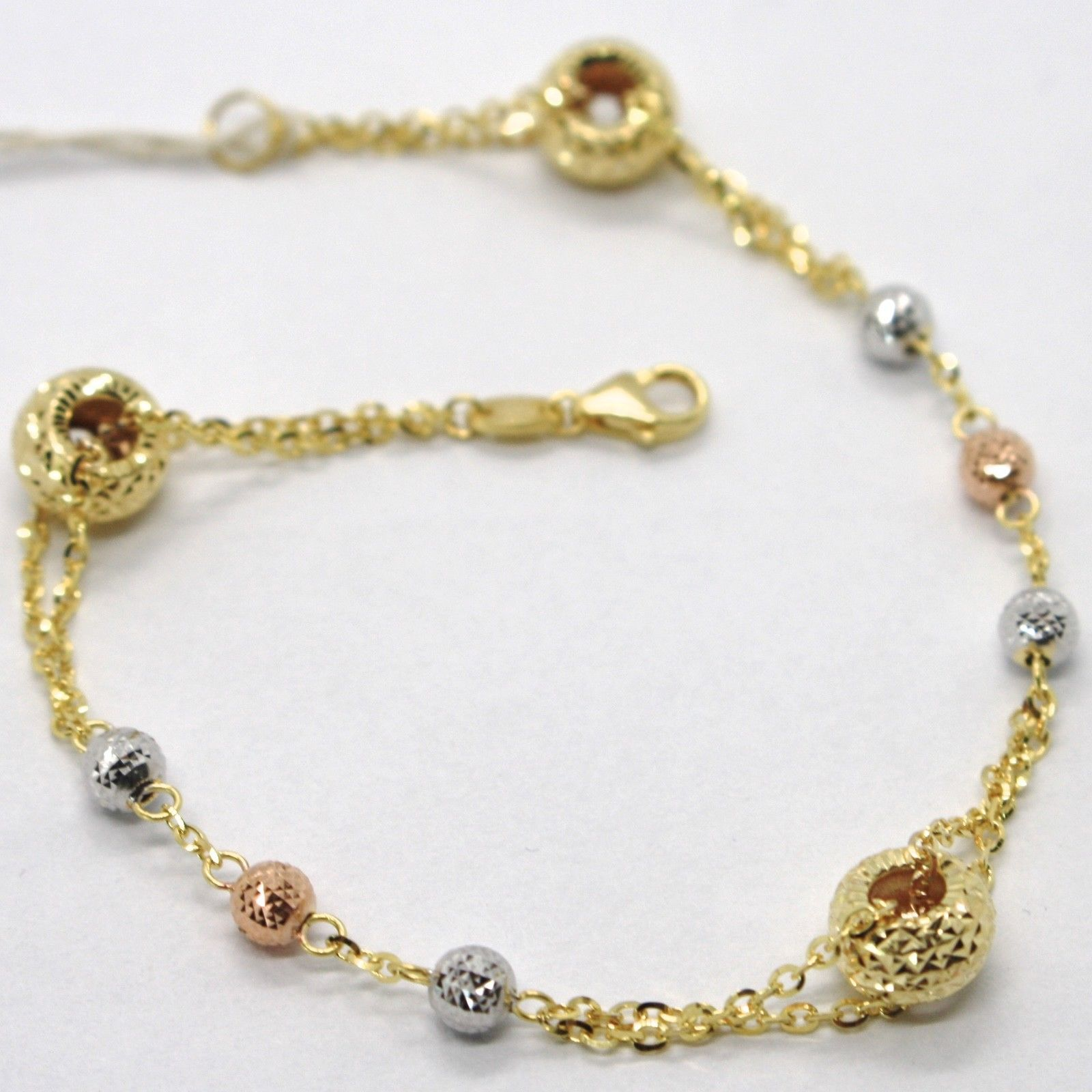 18K YELLOW WHITE ROSE GOLD BRACELET FINELY WORKED CIRCLES, SPHERES & ROLO LINK