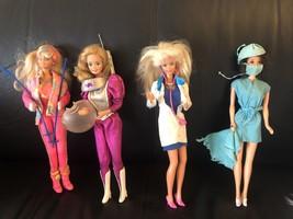 1973 Surgeon Barbie, 1985 Astronaut, 1991 Ski Fun,1993 Dr Barbie Dolls - $123.74