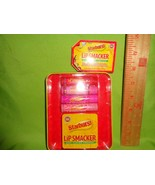 LIP SMACKER 4pc lip Balm gloss with collectible Tin set STARBURST Holida... - $9.89