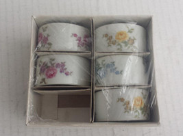 set of 5 ceramic napkin rings with floral pattern  - $9.65