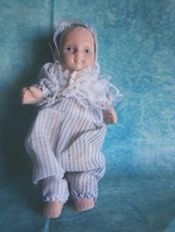 Vintage Small Porcelain Doll Wearing Blue Pinstriped Outfit  - $3.95