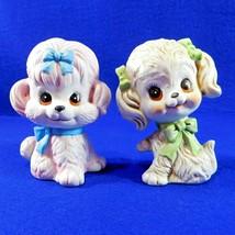 Vintage Pair Dog Figurines Big Eyes Green Blue Bows Bisque Porcelain - $14.50