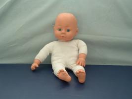 Uneeda brand 2003 soft body vinyl head  laughing  blue eye baby doll  - $28.66