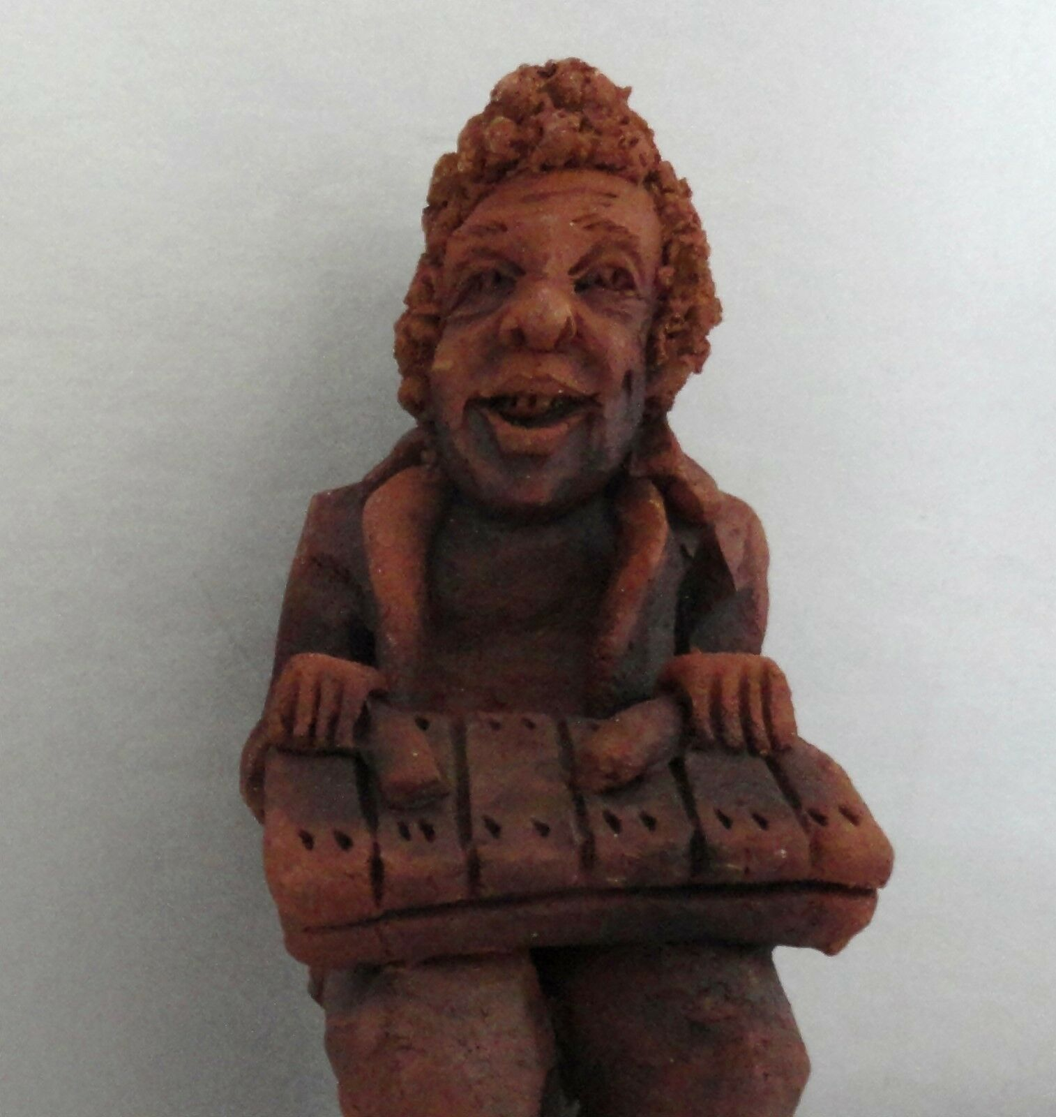 Xylophone Playing Red Clay Musician Figurine