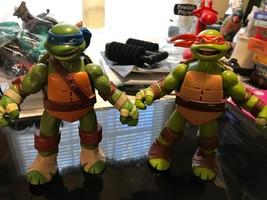 2012 Viacom Playmates Lot of 2 Teenage Mutant Ninja Turtles Talking Figures - $10.79