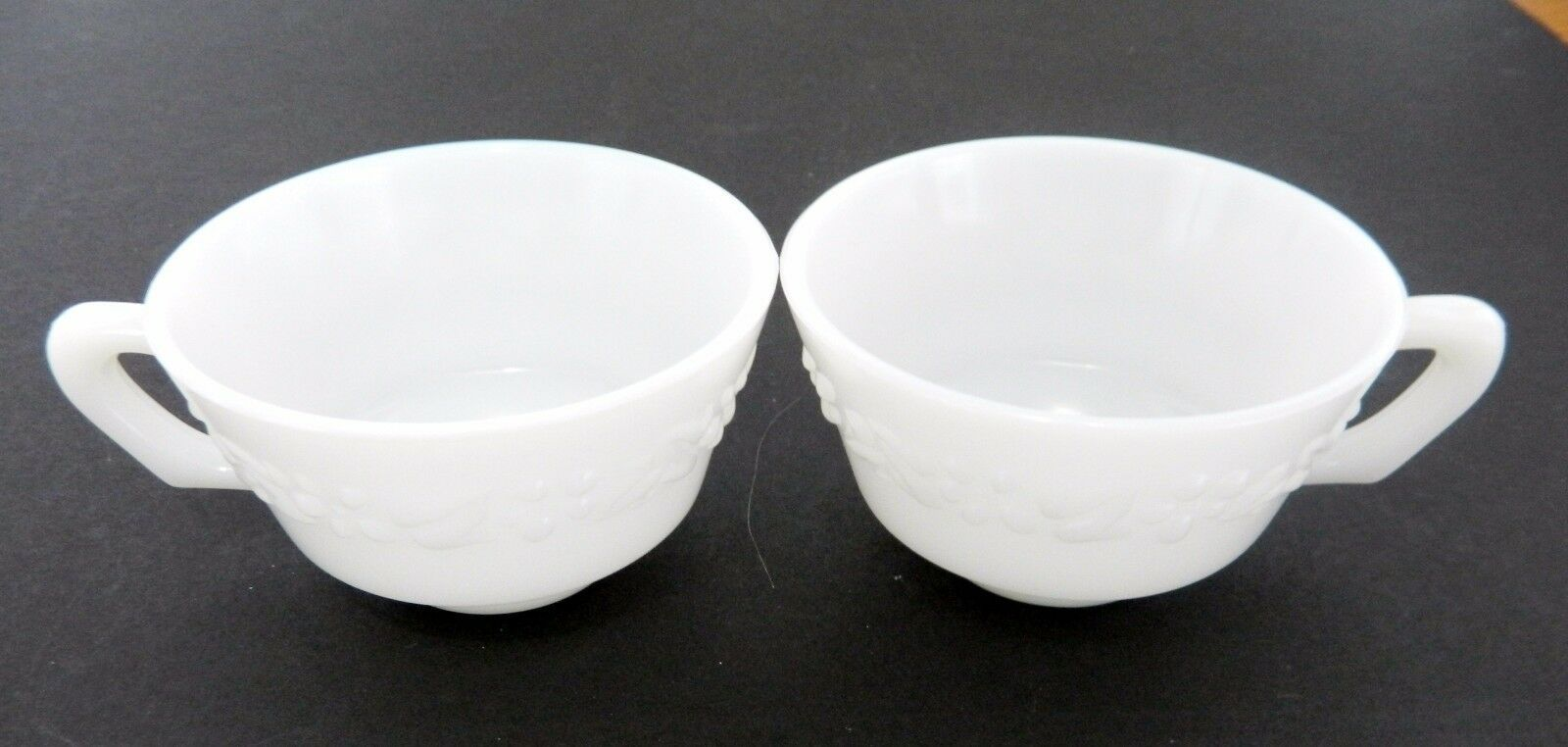 Primary image for Hazel Atlas Milk Glass Coffee / Tea Cups Embossed Floral Print HA Mark Lot of 2