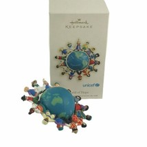 2007 Hallmark Xmas Ornament A World of Hope UNICEF Globe Spins Six Languages - $12.16