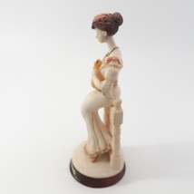 Marlo Collection by Artmark Figurine of Victorian Lady Holding a Yellow Cat image 3