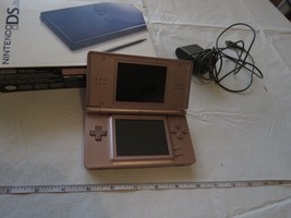 Nintendo DS lite pink game system AS IS NOT WORKING with box charger han... - $45.53