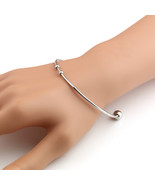 UNITED ELEGANCE Contemporary Silver Tone Necklace and Open Bangle Bracel... - $9.99