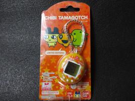 Tamagotchi CHIBI TAMAGOTCHI UNIQLO Limited Edition Orange BANDAI Mega Rare - $44.60