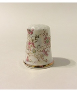 Thimble bird flower bone china  1  25  .25 thumbtall