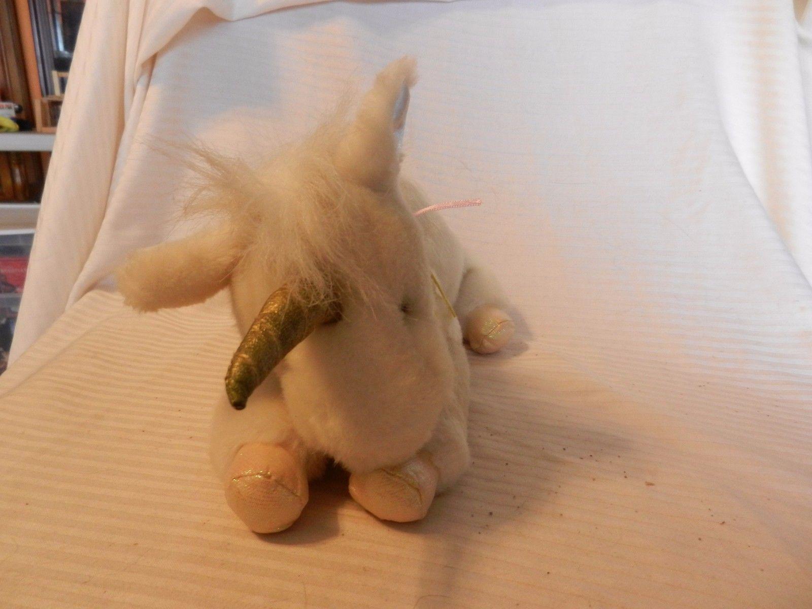 c8c37ba917a8 White Plush Stuffed Unicorn Laying Down, and 13 similar items. S l1600