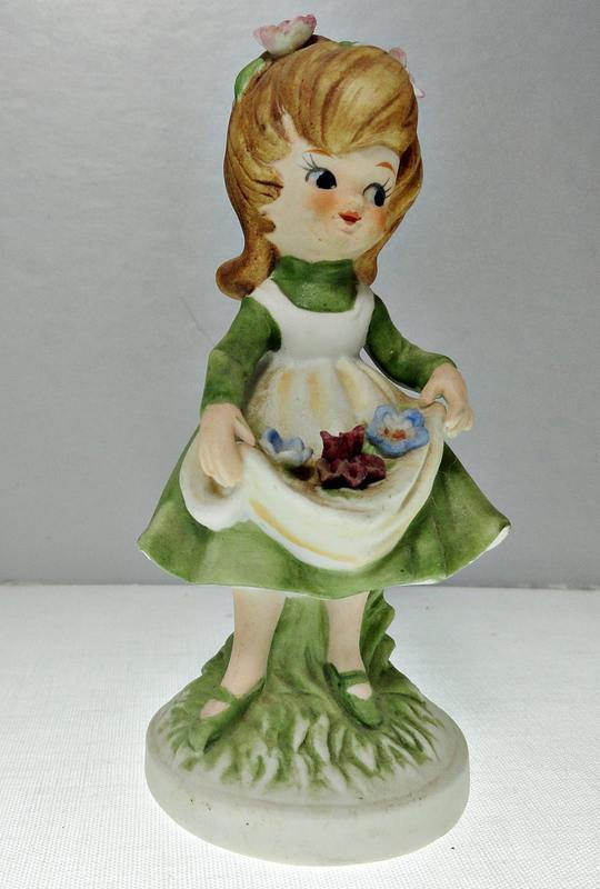 Girl with Flowers in Her Apron Porcelain Figurine