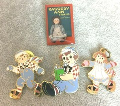 Raggedy Ann Skating Charm Book Cover Pin Andy Reading Pendant Collector - $9.99