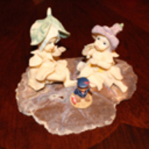Vintage Garden Fairies Playing with a Bear Toy Sitting on a Slab - $49.99