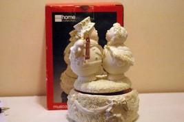 JC Penney Musical Ivory Snowman Couple Figurine - $10.07