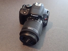 CANON EOS REBEL SL1 (100D) WITH EF-S 18-55 IS STM KIT, CHARGER, AND BATT... - $435.19