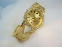 L65, Ladies Gold Tone CUFF Watch, Crystal Surround, Gold Face, wb - $19.83