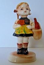 Vintage  Arnart 5th Ave Little Girl Holding flower and basket figurine 1... - $14.44
