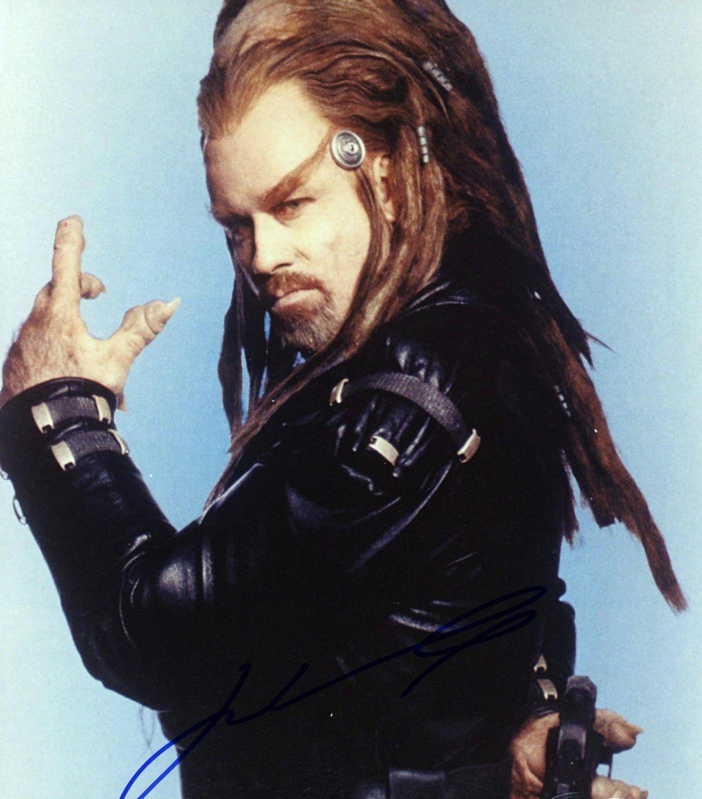 "John Travolta Autographed 8""x 10"" Battlefield Earth Holding Gun"