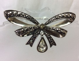 Marcasite Brooch Metal Avon Signed, Crystal Drop, Bow Design. - $8.50