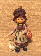 Vintage ornament little girl in bonnet hat with goose and basket Hong Kong - $2.00