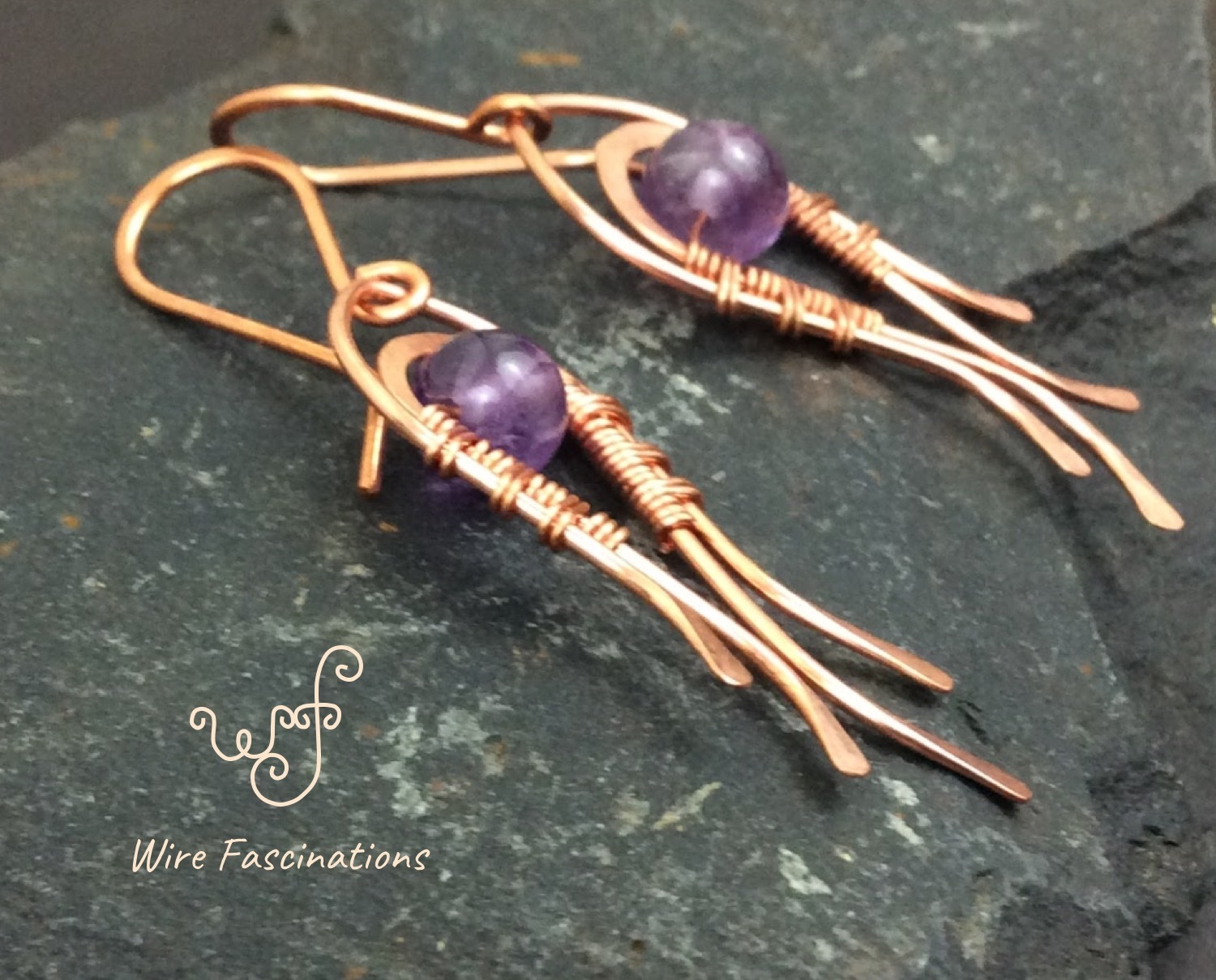 Handmade amethyst earrings: wire wrapped flowing curves