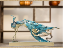 This is a very delicate sculpture of a peacock - $1,680.00