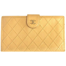 Vintage CHANEL beige caviarskin wallet with gold tone CC motif. Classic color - $405.00