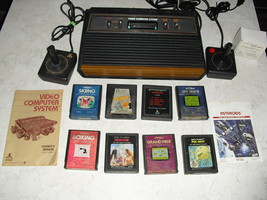 Atari 2600 4 SWITCH with joysticks, adapter, 8 GAMES  pac-man , qbert, defender - $148.49