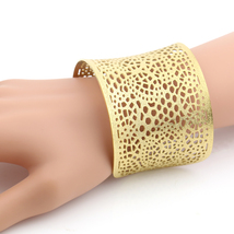 United Elegance Stylish Gold Tone Cuff Bracelet With Lace Cut Out Design - $19.99