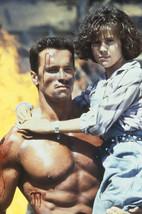 Arnold Schwarzenegger and Alyssa Milano in Commando 18x24 Poster - $23.99