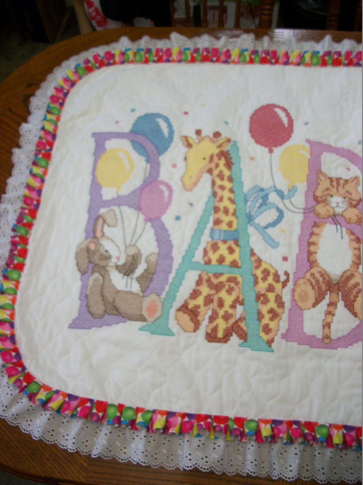 "COMPLETED & QUILTED Sunset Xstitch Baby Quilt  ""SNUGGLE"" + add Baby's Name extra"