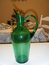 VINTAGE GREEN GLASS PITCHER  12 INCHES HIGH 6 INCHES WIDE 2 INCH OPENING - $24.74