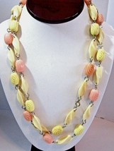 LONG PINK AND YELLOW VINTAGE PLASTIC NECKLACE ON WIRES TWISTED AND CARVE... - $37.00