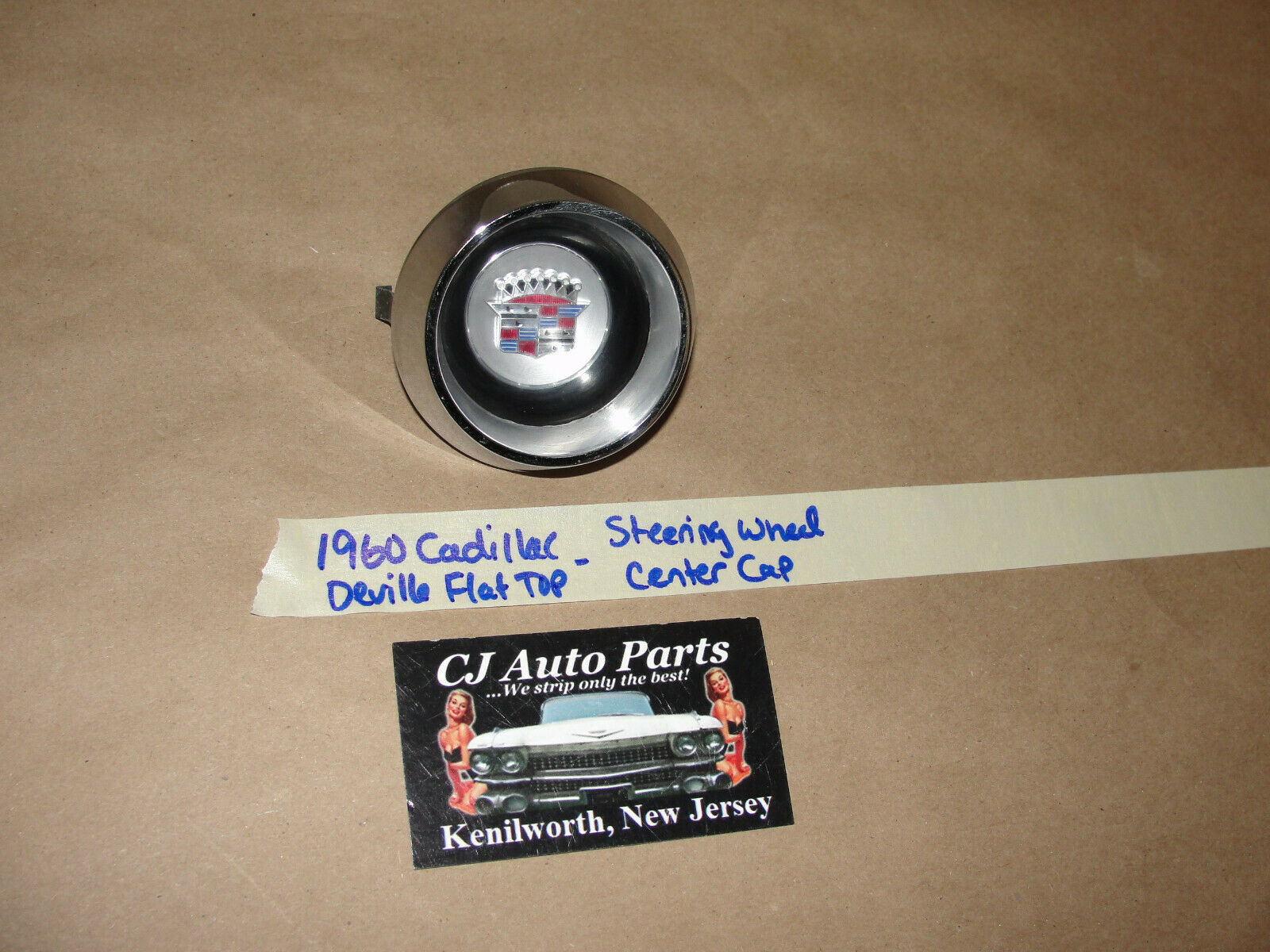 Primary image for 60 Cadillac Deville FLAT TOP STEERING WHEEL HORN BAR CENTER CAP TRIM W/ EMBLEM