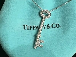 Tiffany & Co. Platinum & Diamond Skull Key Necklace 18 Inch Chain - $2,277.00