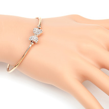 UE- Trendy Rose Tone Designer Bangle Bracelet With Swarovski Style Crystal Bow  - $18.99
