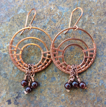 Handmade copper earrings: large concentric circles with garnet dangles - $65.00