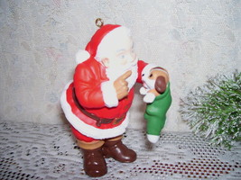 HALLMARK ORNAMENT SANTA CLAUS WITH PUPPY IN STOCKING 1998 - $15.98