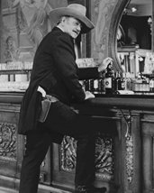 John Wayne in The Shootist iconic pose at saloon bar whisky bottle gun b... - $69.99