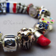 Francophile European Charm Bracelet With Flag Of France And Eiffel Tower Beads - $86.00