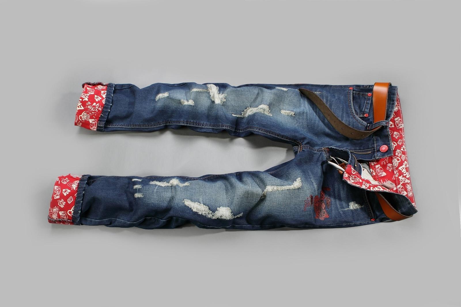 Men's pants tide Jean crimping loose multi hole flanging jeans