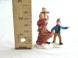 Christmas Village Figurine Woman Brown Dress Boy Carrying Girl Mother Ch... - $8.99
