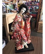 Asian Doll Free Standing On Wooden Platform Made Of Material - $62.85