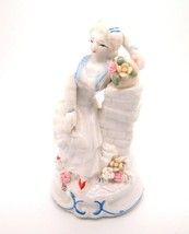 Vtg Girl with Flowers White blue Pink Figurine by Hainan Arts & Crafts S... - $14.97