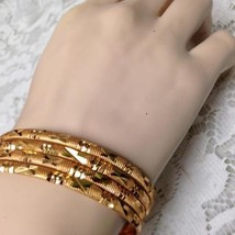 Elegant, Gold 4pc 1/8in W Etched Floral Design Child-Teens 7in C Bangle ... - $21.80