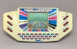 Vintage 1995 Tiger Electronics Wheel of Fortune Handheld Video Game & ca... - $9.50