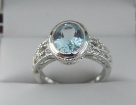 BLUE TOPAZ AND DIAMOND RING IN 14K WHITE GOLD SZ 7.25 - $278.32